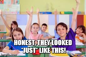 Class full of children with their hands up to ask questions