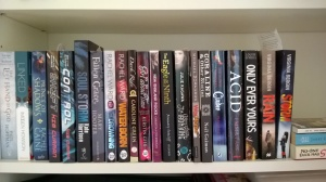 A row of my YA books, spine out